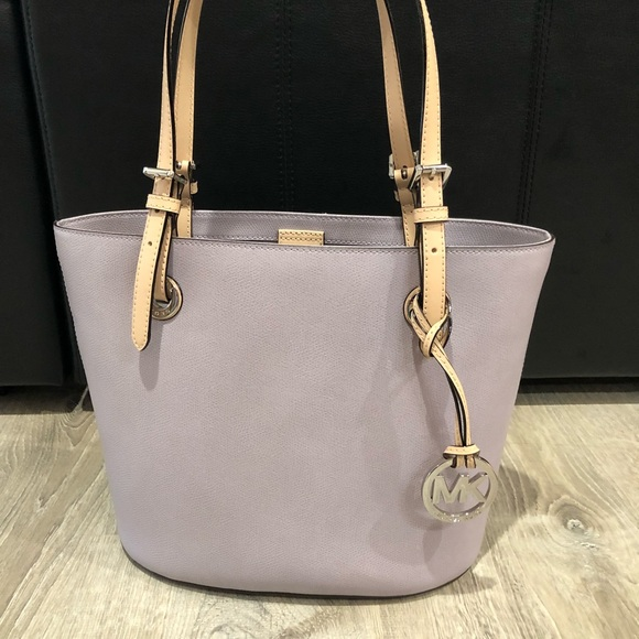 aa0a68c50b23 Michael Kors Jet Set Item MD Tote Lilac Color. M 5b0a2d2b05f43069816833bb.  Other Bags you may like